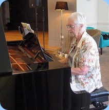 Dorothy Waddel playing the grand piano. Photo courtesy of Dennis Lyons.