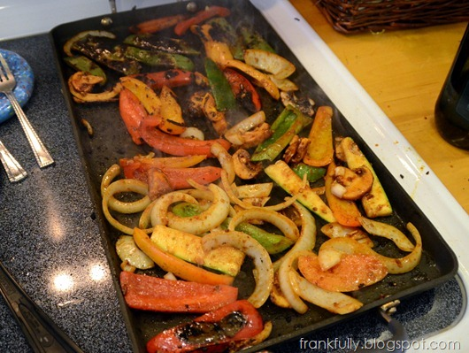 veggies cooking on the griddle