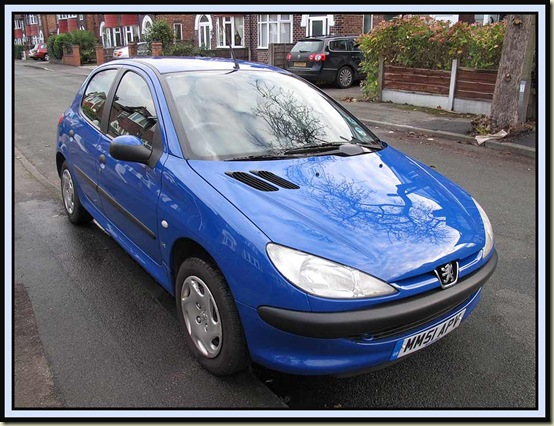 Peugeot 206 for sale - the white marks are reflections, not scratches!