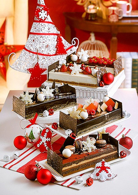 Obolo Signature Christmas Log Cakes New York Cheesecake  fresh strawberries  Raspberry Lemon Cheesecake Noisette Carachoc Dark chocolate genoise, caramel chocolate mousse, salted caramel bavarois praline feulletine Fleur de Sel