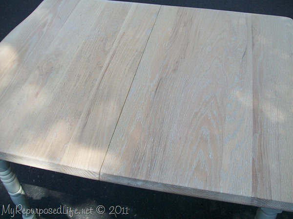I sanded the table top to reveal the pretty wood