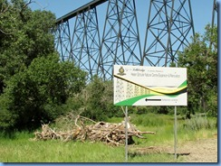 1662 Alberta Lethbridge - Helen Schuler Nature Centre sign with High Level Bridge in background