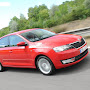 2013-Skoda-Rapid-Sedan-Red-Color-4.jpg