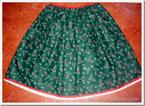 Full skirt made from cardinal and holly print fabric and trimmed with bias tape and lace.  Perfect for Christmas.