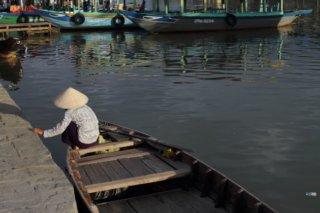 Old Women make a living by rowing boats at Hoi An