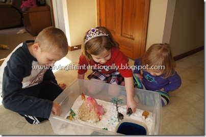 Science Fun with Dinosaur Sensory Bin with Erupting Volcano