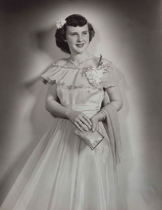 1940s full-length portrait of a young woman wearing a formal gown, photo by Strands Studio of Rugby, North Dakota