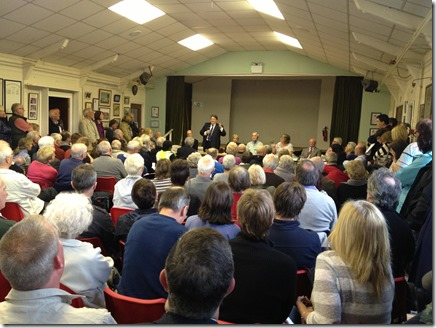 Councillor Michael Jones speaks to a packed audience at the Wistaston Parish Council meeting on 16-5-13