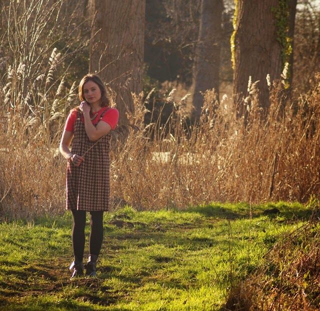 girl standing in the reeds on riverbank