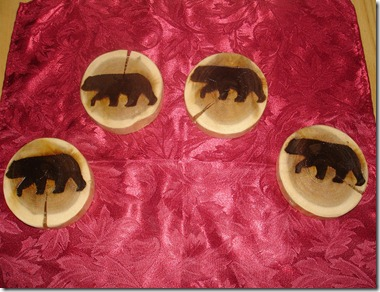 burned images of bears on wood coasters