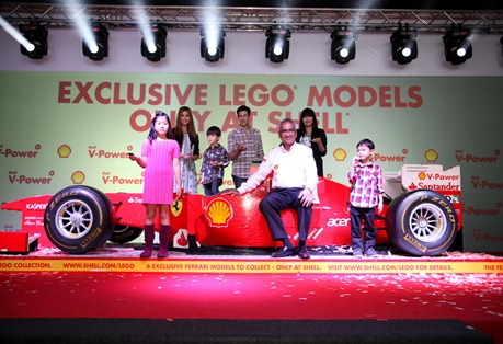 Pic 4 - Tuan Haji Azman Ismail with the complete set of the Lego Models