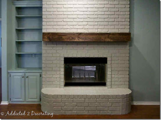 rough hewn wood fireplace mantel addicted 2 decorating rh addicted2decorating com wood mantel on brick fireplace wood beam fireplace mantel