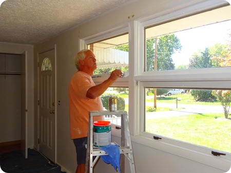 Paul painting windows.
