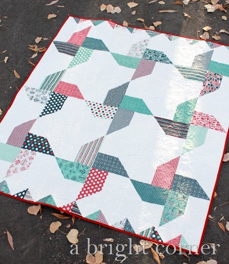 Jolly Pinwheels free quilt pattern by Andy of A Bright Corner - perfect for Jolly Bars or a Layer Cake