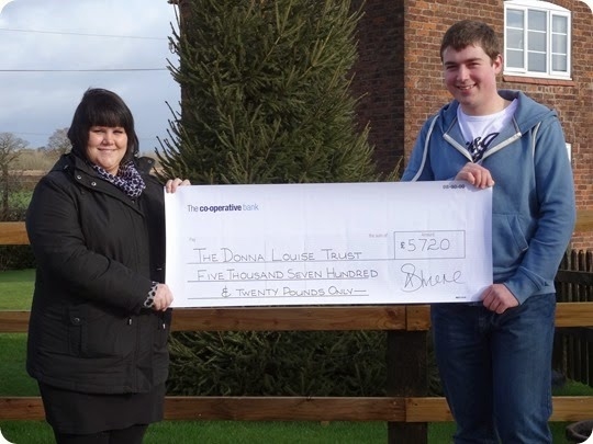 Nikki Wrench from The Donna Louise Childrens Hospice  receives the cheque from Graham Witter
