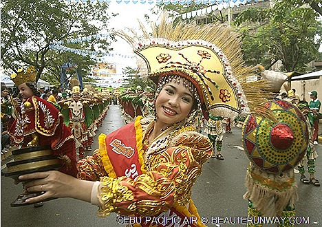 Cebu Sinulog Festival January CEBU PACIFIC AIR colourful costumes traditional dancing Malapascua Island Puerto Princesa Underground River 7 Wonders of Nature whale sharks Donsol dolphins Pamilacan Puerto Princesa Legazpi.