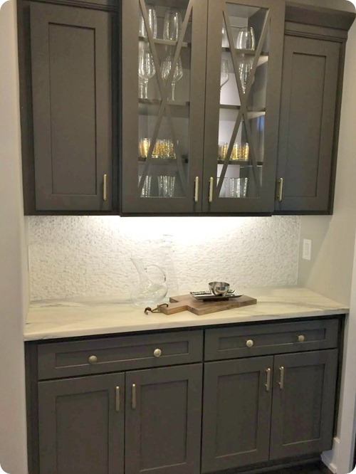 gray cabinets with brass