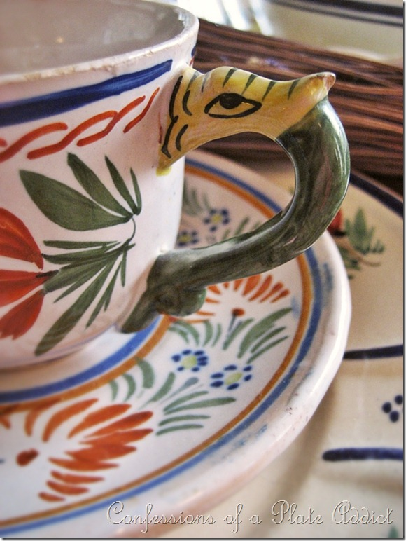 Quimper cup and saucer with dragon handle