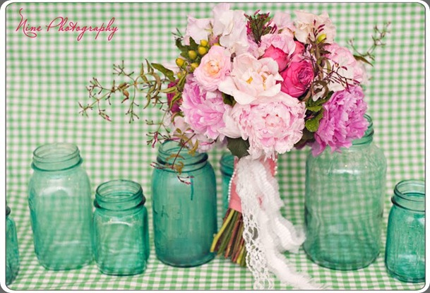 blue mason jar pink flowers bows and arrows