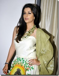 Madhurima Banerjee posing in Sleeveless White Buddha Printed Long Dress