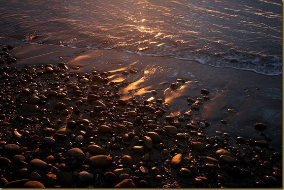 Sunrise beach pebbles