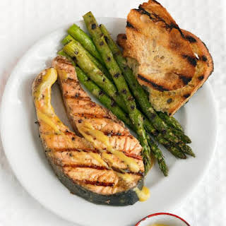 Grilled Salmon Steaks with Mustard Sauce and Asparagus.