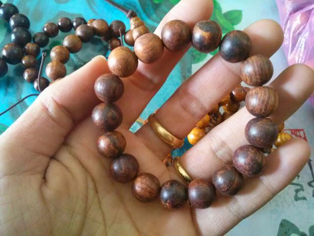 Vòng tay gỗ sưa 14 mm hạt mộc