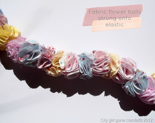 fabric puff balls strung on to elastic