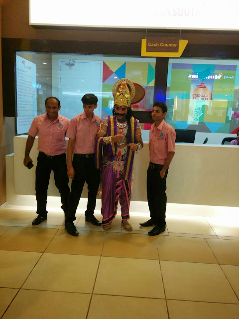 Man dressed up as King Mahabali at Forum Mall, Mangalore on Onam