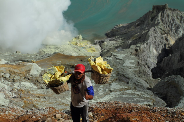 These sulphur miners always smile in spite of their hellish life