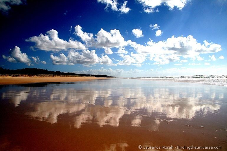 Clouds reflecting in the water on the Fraser island beach - Queensland - Australia