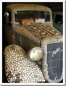 1937 Austin covered in 27000 shells.