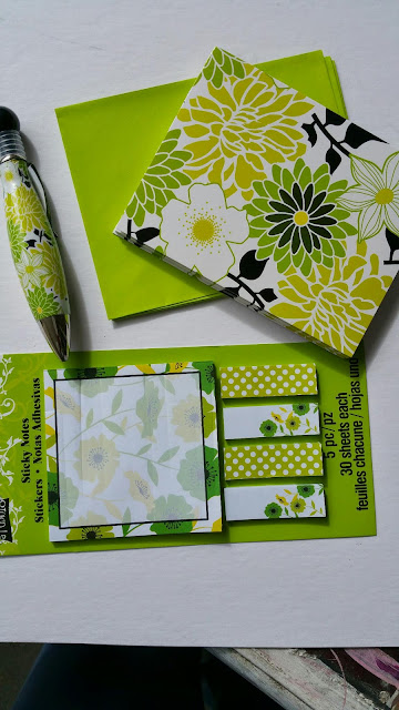 Michaels green yellow and black note card, pen and post it and flags
