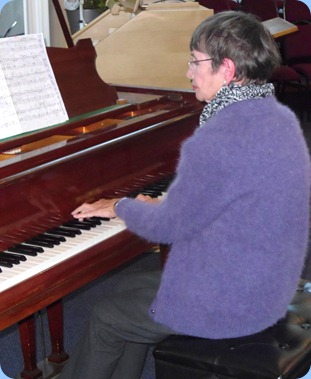 Club Secretary, Colleen Kerr, playing The Holy Cross Church's Broadwood Grand Piano.