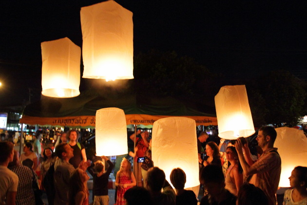Celebrating New Year by leaving floating lanterns into the sky, chiang mai, thailand