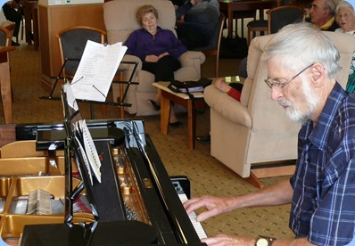 Errol Storey playing the grand piano. Photo courtesy of Dennis Lyons.