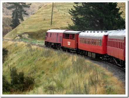 Dg770 English Electric diesel with 4 carraiages, 2 open viewing wagons and a guards van.