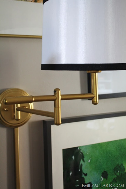 brass wall lamp with ribbon trim