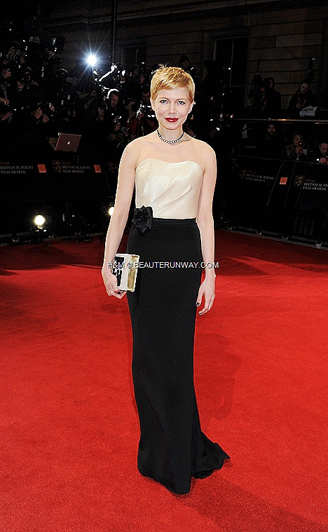 Michelle Williams HM dress gold bodice trumpet skirt in satin back crepe organic cotton BAFTA Awards