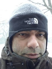 Promod Sharma after removing snow from the driveway