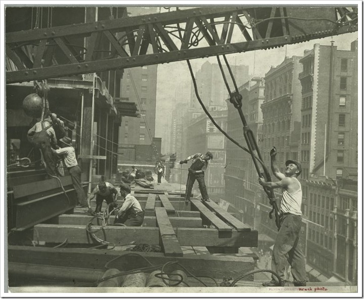 Workers-guiding-hoisting-cable-1931