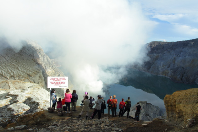Tourists enjoying the Kawah Ijen view
