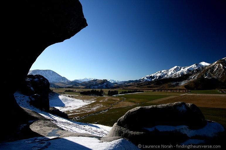 boulders snow mountains sky