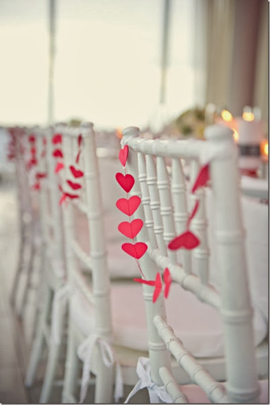 adorn dining chairs with hearts pennants for valentine's day #valentinesday