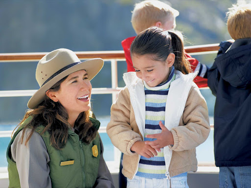 Princess-Cruises-guide-Alaska - A guide has some fun with a young passenger during a Princess Cruises sailing through Alaska's Glacier Bay.