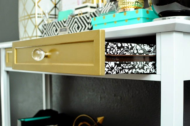 Lining drawers with contact paper is an inexpensive way to make furniture look more high end and beautiful.