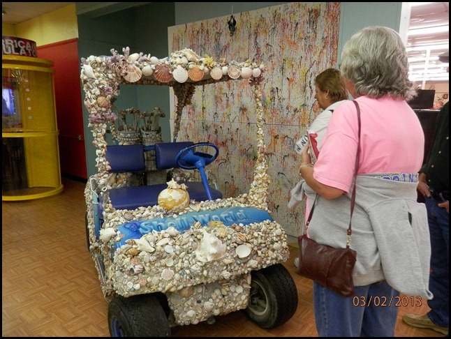Golf cart covered in sea shells