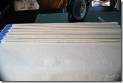 Folding along the stitched lines and then pressing in the fold.