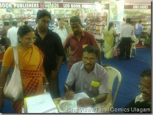 CBF Day 05 Photo 05 Stall No 372 Award Winning Celebrity RJ Ophe's Father Fills Up Subscription Form