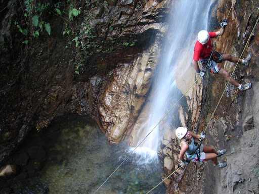 Guides help travelers rappel down a waterfall north of Puerto Vallarta, Mexico.